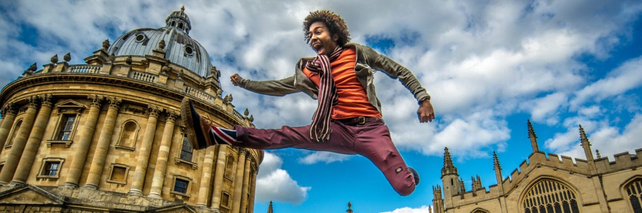 Scio Study Abroad Radcliffe Camera Student Jumping